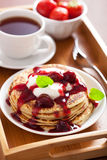 Pancakes with cherry jam and cream for breakfast Royalty Free Stock Image