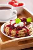 Pancakes with cherry jam and cream for breakfast Stock Photo