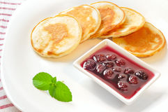 Pancakes with cherry jam in square  plate Stock Images