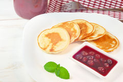 Pancakes with cherry jam in square  plate on the wooden table Stock Photo