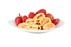 Pancakes with cherry jam and strawberries Stock Image