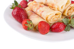 Pancakes with cherry jam and strawberries Stock Photos