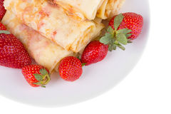 Pancakes with cherry jam and strawberries Royalty Free Stock Photography
