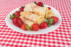 Pancakes with cherry jam and strawberries Royalty Free Stock Photo