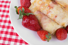 Pancakes with cherry jam and strawberries Stock Photography