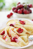 Pancakes with cherry and pine nuts Royalty Free Stock Images