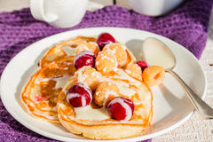 Pancakes with cherry, raspberry and vanilla sauce Royalty Free Stock Photos