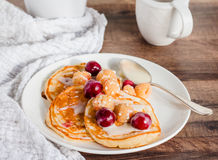 Pancakes with cherry, raspberry and vanilla sauce Stock Photography