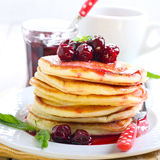Pancakes with cherry sauce Royalty Free Stock Image