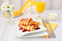 Pancakes with cherry syrup and orange juice Stock Image