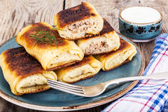 Pancakes with Chicken, Mushrooms and Meat Royalty Free Stock Images