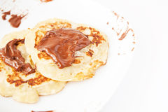 Pancakes with chocolate Stock Images