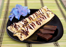 Pancakes with chocolate. Pancakes topped with chocolate on a plate stock photography