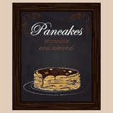 Pancakes with chocolate and almond on the plate Stock Photos
