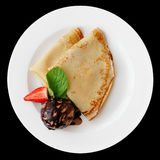 Pancakes with chocolate ice cream isolated on black Royalty Free Stock Photo