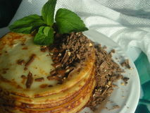 Pancakes with chocolate and mint. Tasty sweet meal decorated with mint Stock Photos