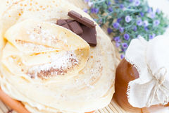 Pancakes with chocolate, powdered sugar and honey Royalty Free Stock Photo