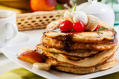 Pancakes with chocolate sauce fruit and coffee. American pancakes with chocolate sauce fruit and coffee Stock Photo