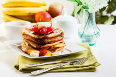 Pancakes with chocolate sauce fruit and coffee. American pancakes with chocolate sauce fruit and coffee Royalty Free Stock Photos
