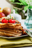 Pancakes with chocolate sauce fruit and coffee. American pancakes with chocolate sauce fruit and coffee Royalty Free Stock Images