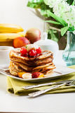 Pancakes with chocolate sauce fruit and coffee. American pancakes with chocolate sauce fruit and coffee Stock Photos