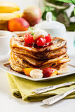 Pancakes with chocolate sauce fruit and coffee Stock Photography