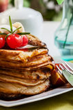 Pancakes with chocolate sauce fruit and coffee. American pancakes with chocolate sauce fruit and coffee Royalty Free Stock Photo