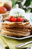 Pancakes with chocolate sauce fruit and coffee. American pancakes with chocolate sauce fruit and coffee Royalty Free Stock Image