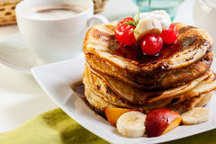 Pancakes with chocolate sauce fruit and coffee. American pancakes with chocolate sauce fruit and coffee Stock Image