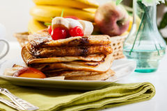 Pancakes with chocolate sauce fruit and coffee Stock Photo