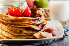 Pancakes with chocolate sauce fruit and glass of milk Royalty Free Stock Images