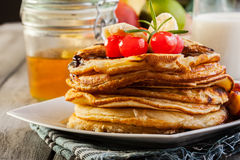 Pancakes with chocolate sauce fruit and glass of milk. American pancakes with chocolate sauce fruit and glass of milk Royalty Free Stock Photography