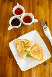 Pancakes with chocolate sauce and green tea Stock Images