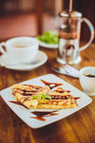Pancakes with chocolate sauce and green tea Royalty Free Stock Photo