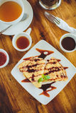 Pancakes with chocolate sauce and tea Royalty Free Stock Photo