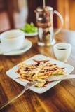 Pancakes with chocolate sauce and tea Stock Photo