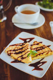 Pancakes with chocolate sauce and tea Stock Photo