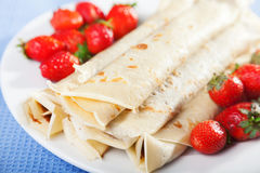 Pancakes with chocolate and strawberries. For breakfast, close up Stock Images