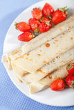 Pancakes with chocolate and strawberries. For breakfast, close up Royalty Free Stock Photography