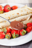 Pancakes with chocolate and strawberries. For breakfast, close up Royalty Free Stock Images