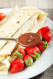 Pancakes with chocolate and strawberries. For breakfast, close up Royalty Free Stock Image
