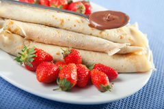 Pancakes with chocolate and strawberries. For breakfast, close up Stock Photography