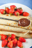 Pancakes with chocolate and strawberries. For breakfast, close up Stock Photo