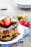 Pancakes with chocolate, strawberries and kiwi Royalty Free Stock Photo