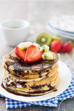 Pancakes with chocolate, strawberries and kiwi Stock Photo