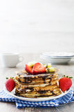Pancakes with chocolate, strawberries and kiwi Royalty Free Stock Photos