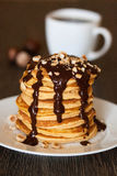 Pancakes with chocolate syrup. 