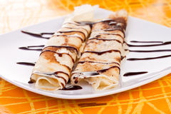 Pancakes with chocolate syrup Stock Photography