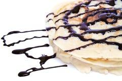 Pancakes with chocolate syrup Stock Photos