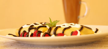 Pancakes. With chocolate syrup. Shallow depth of field Royalty Free Stock Image